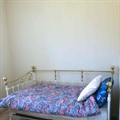 Vista Apartments Second Bedroom Bed